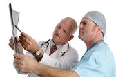 Doctor & Intern Examining Xray — Stock Photo