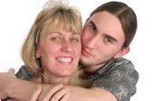 Teen Son Kisses Mom — Stock Photo