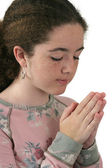 An attractive teen girl praying — Stock Photo