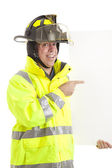 Enthusiastic Firefighter with Sign — Stock Photo