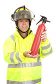 Fireman Demonstrates Fire Extinguisher — Stock Photo