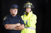 Fireman and Policeman with Copyspace — Stock Photo