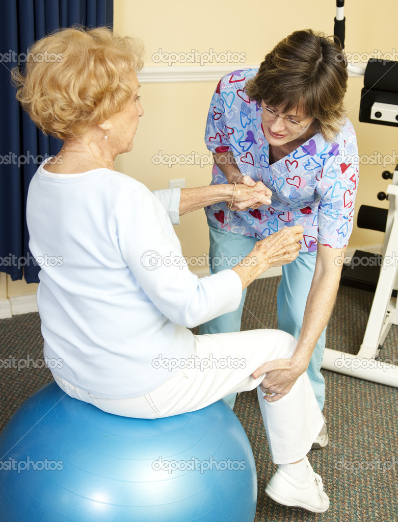Senior woman on yoga ball, working with a physical therapist.   — Stock Photo #6801595