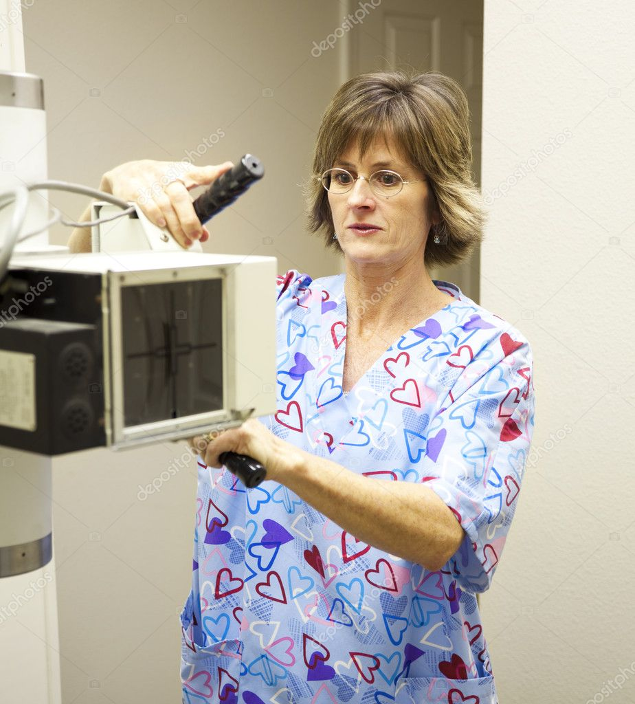 Radiology technician sets up the x-ray machine.   — Stock Photo #6801607
