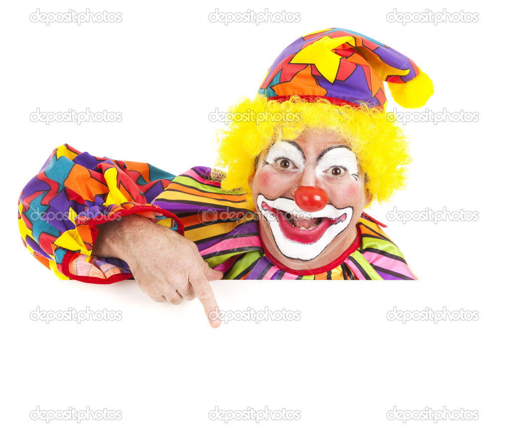 Cheerful clown pointing to blank white space.  Isolated design element. — Stock Photo #6802273