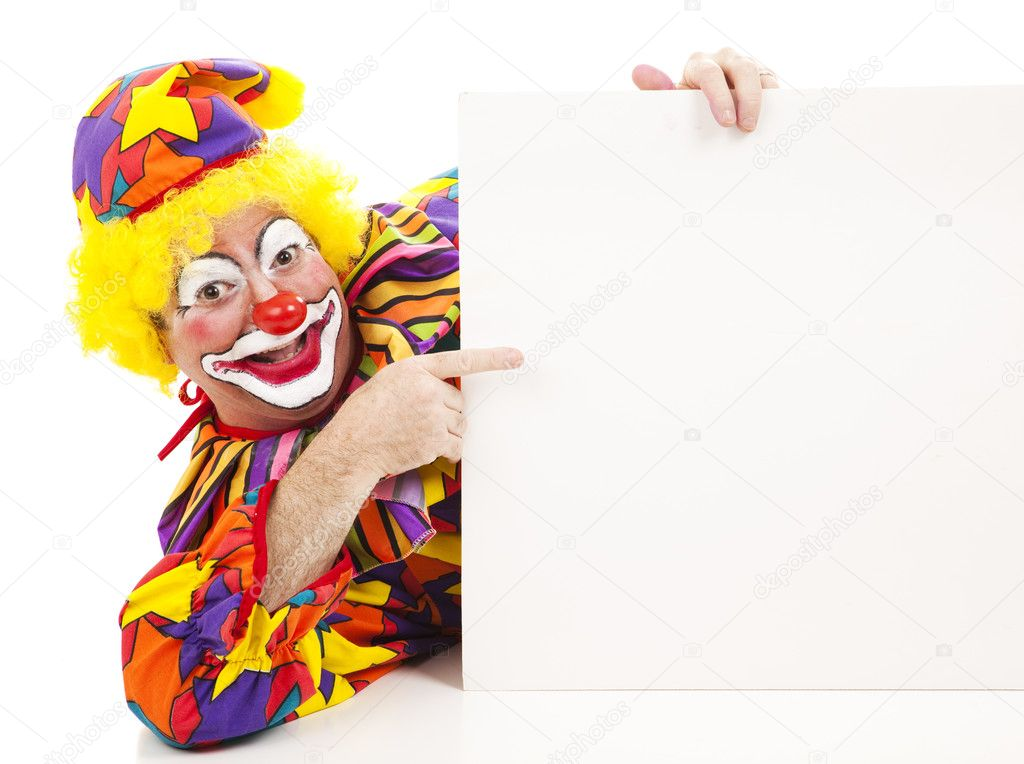 Cheerful birthday clown pointing at a blank sign.  Isolated on white.   — Stock Photo #6802276