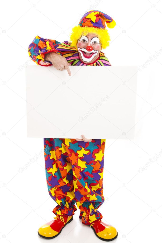 Full body isolated view of a friendly circus clown holding a black white sign.    Stock Photo #6802318