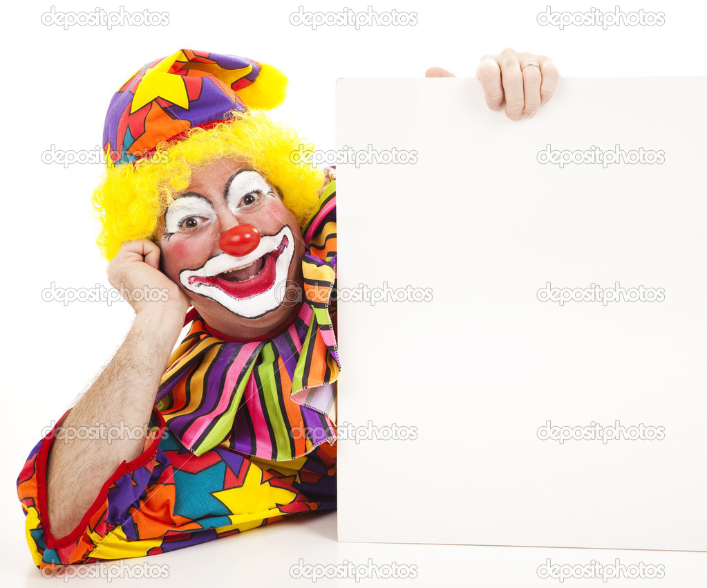 Clown lying on his side holding a blank white sign.   — Stock Photo #6802441
