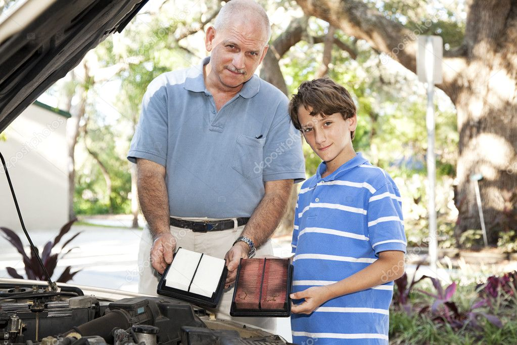 Father and son changing the air filter in the family car.   — Stock Photo #6802637