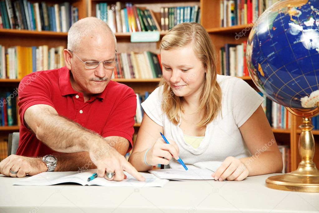 Father or teacher helping teen girl with homework.   — Stock Photo #6802666