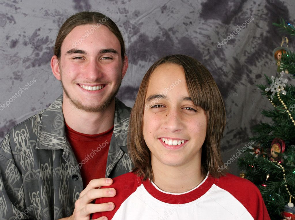 Two teen brothers posing for a Christmas portrait. — Stock Photo #6803552