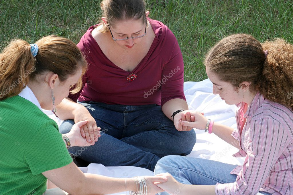 A group of teen girls having a prayer circle outdoors. — Stock Photo #6804314