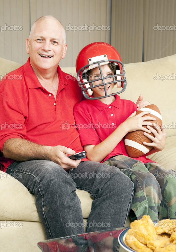 Father and his son watching a football game together.   — Stock Photo #6804535