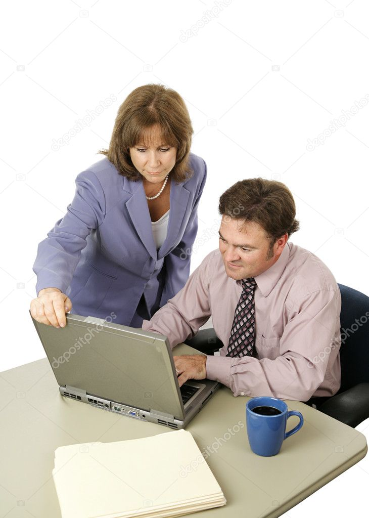 A male-female business team working intensely trying to meet a deadline.  Isolated on white.  Lizenzfreies Foto #6805116