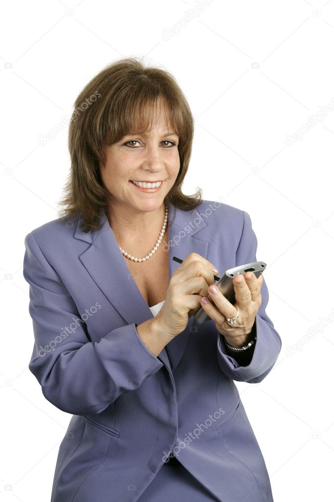 A pretty businesswoman using her PDA. — Stock Photo #6805133