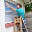 Stock Photo: Taping Window Glass
