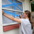 Stock Photo: Teen Taping Windows H