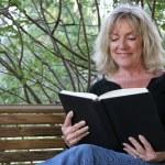 Enjoying A Book — Stock Photo #6813976