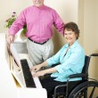 Church Pianist in Wheelchair - Stock Photo