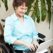 Постер, плакат: Disabled Woman with Laptop