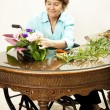 In Wheelchair Arranging Flowers — Stock Photo
