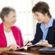 Mature Businesswomen Discuss Contract — Stock Photo