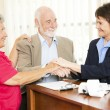 Senior Business Group Handshake — Stockfoto