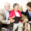 Foto de Stock  : Senior Couple and Saleswoman