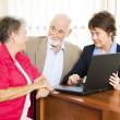 Senior Couple with Financial Advisor — Stock Photo