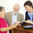 Senior Financial Advice - Sign Here — Stock Photo #6815995