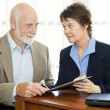 Senior Man Signs Paperwork - Serious — Stock Photo