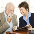 Stock Photo: Senior Reluctant to Sign Contract