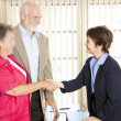 Seniors Meeting Financial Advisor - Stock Photo