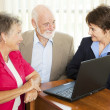 Seniors and Financial Advisor — Stock Photo