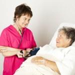 Taking Blood Pressure in Hospital — Stock Photo