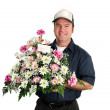 Friendly Flower Delivery Man — Stock Photo