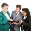 Stock Photo: Diverse Business Group - Troubling Report