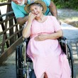 Royalty-Free Stock Photo: Caring for Disabled Wife