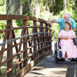 Disabled Senior Couple in Park — Stock Photo #6816948