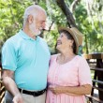 Flirty Senior Couple Outdoors — Stock Photo
