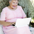 Reading E-mail Outdoors — Stock Photo #6816989