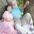 Relaxed Seniors Birdwatching - Stock Photo
