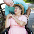 Stock Photo: Senior Couple Caretaker