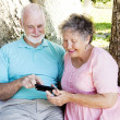 Senior Couple Reads Text Message — Stock Photo #6817054