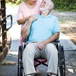Senior Man and Caretaker — Stockfoto