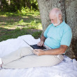 Senior Man in Park With Computer — Stock Photo