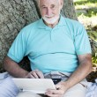Senior Man with Netbook — Stock Photo