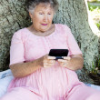Senior Woman Confused by Texting — Stock Photo
