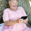 senior woman texting — Stock Photo