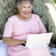 Senior Woman With Netbook — Stock Photo #6817101